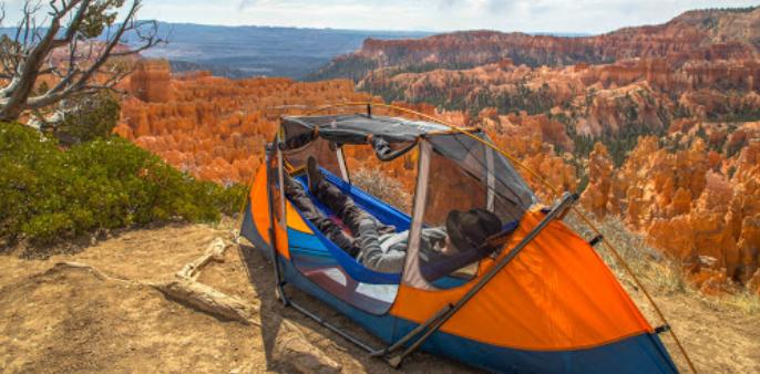 A tent camped on dry terrain